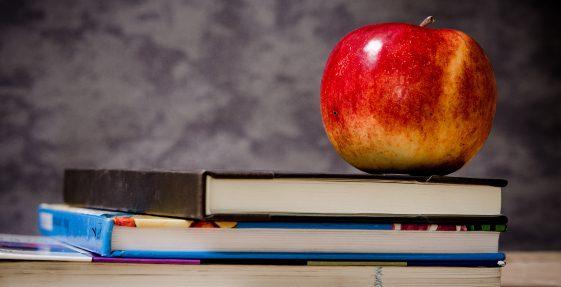 Books and an apple|Paradigm Dental Austin TX